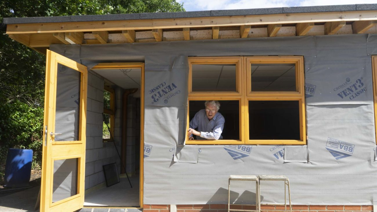image of school architect Keir Polyblank looking out of the new science block building work